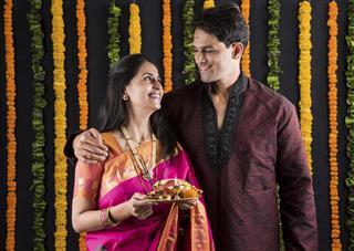 Portrait of Maharashtrian couple holding a puja thali