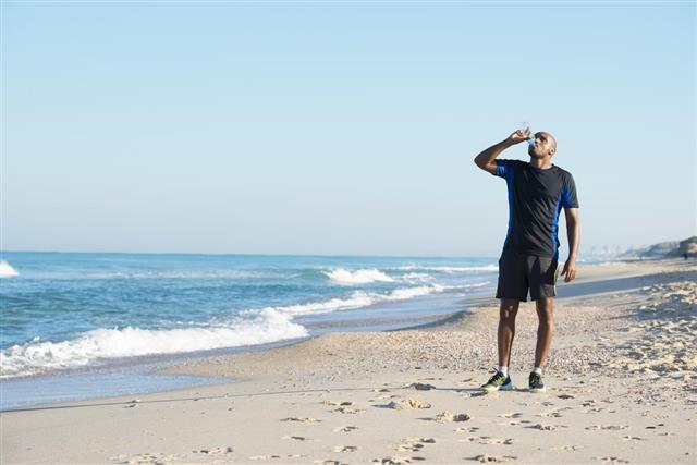 Athlete man drinking water