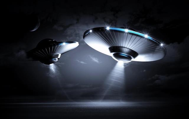 Three UFO shining over the dark night