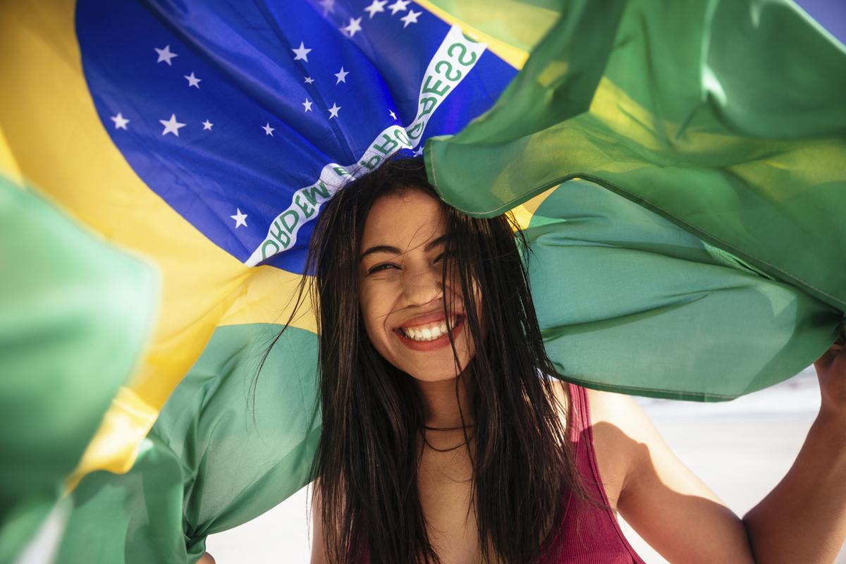 Cheering woman under brazilian flag