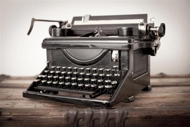 Vintage Black Manual Typewriter on White Background