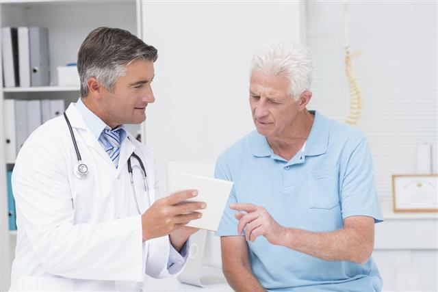 A doctor explaining a prescription to a senior patient