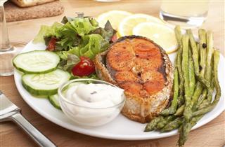 Salmon with vegetables lemon and sauce