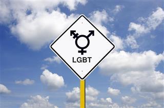 Transgender LGBT Road Sign in Front of a Blue Sky