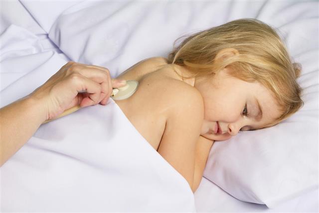 Pediatric doctor examine little girl with stethoscope