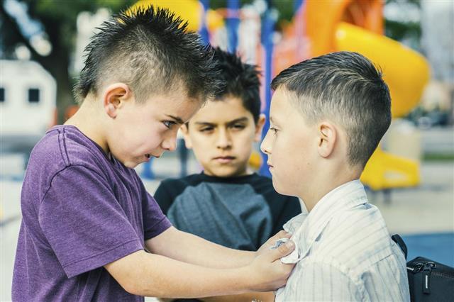 Little bully bullying older boy