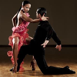 Latino dance couple dancing in ballroom