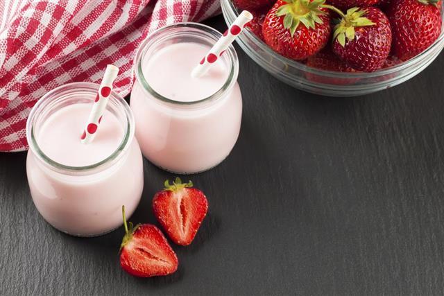 Smoothie dessert yogurt or milkshake with frozen blueberry and oats