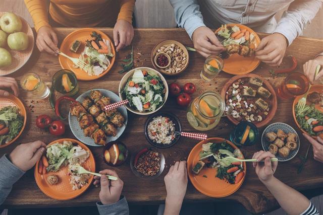 Enjoying dinner with friends.