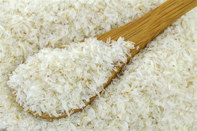 Spoon of dried psyllium husk fiber to relieve constipation