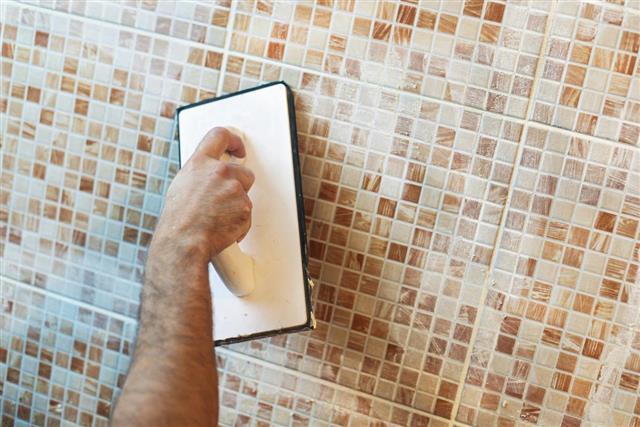 Applying grout on ceramic tiles
