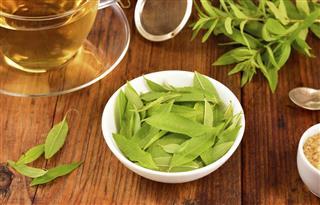 Lemon verbena leaves and tea on table