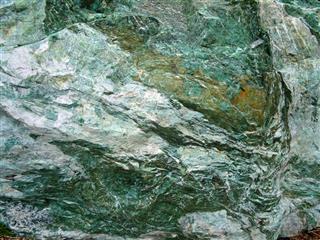 Image of large green marble rock quartz veins metamorphic rock-surface
