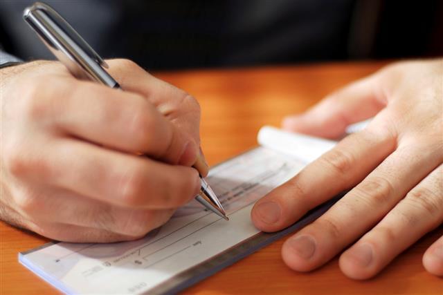 Man writing a check