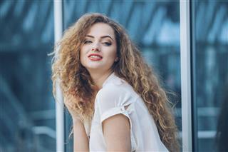 Beauty Girl Outdoors enjoying nature. Beautiful Teenage Model girl with