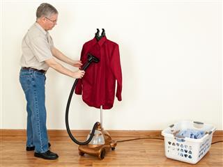 Man Using a Clothes Steamer
