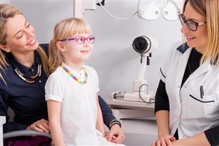 Little girl trying on optic glasses