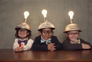 Nerd Children Wearing Lighted Mind Reading Helmets
