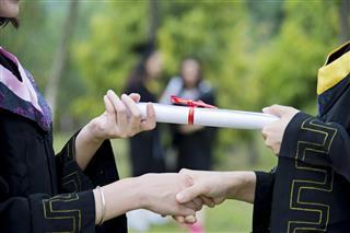 Graduate receiving a degree
