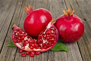 Fresh ripe pomegranates with leave