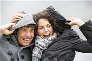 Couple Enjoying Rainy Day