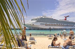 Cruise Ship Passengers Enjoying The Beach