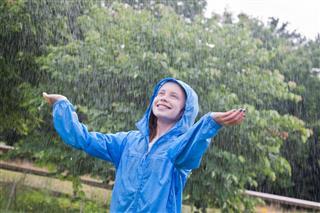 Boy Enjoying Rain