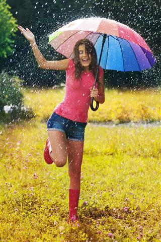 Beautiful Woman Having Fun In Rain