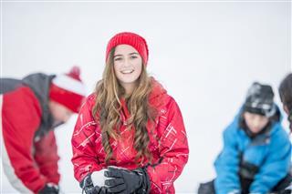 Teenage Girl Making Snowballs