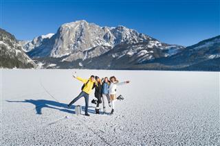 Friends Having Fun On Frozen Lake