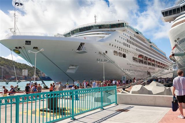Cruise Ship Passengers On Dock