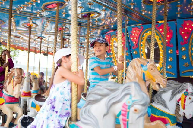 Kids On At Amusement Park