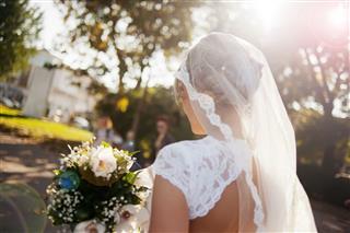 Beautiful Bride Holding Flower Bouquet