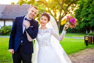Happy Wedding Couple Holding Hands