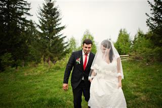 Wedding Couple Under The Rain