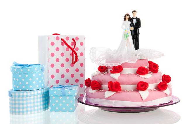 Couple On Top Of Wedding Cake