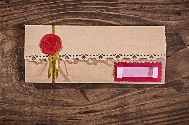 Invitation Envelope On Wood Close Up