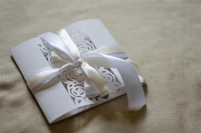 Invitation card with satin ribbon