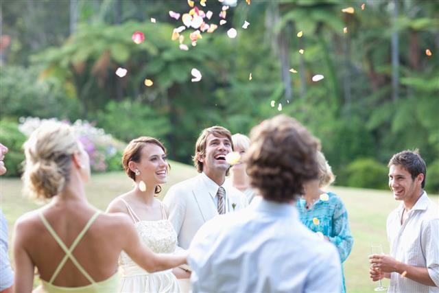 Guests throwing rose petals