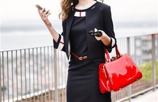 Fashion Model Holding Bag