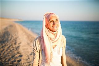 Happy Muslim Woman On The Beach