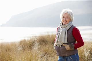 Woman Walking Through Sand Dunes