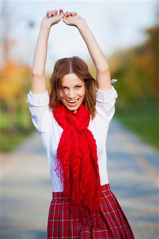 Schoolgirl In Red Skirt