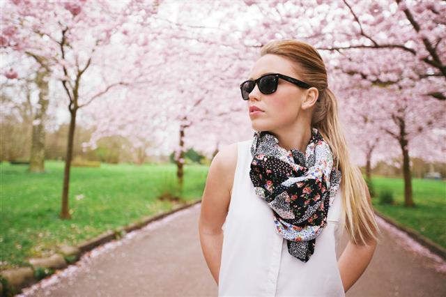 Woman in black printed scarf
