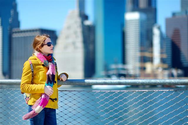 Woman Sightseeing By Brooklyn Bridge