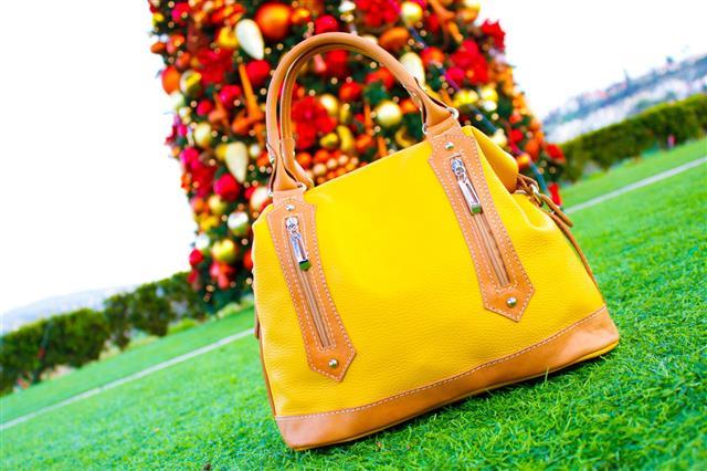 Yellow Handbag Under A Christmas Tree