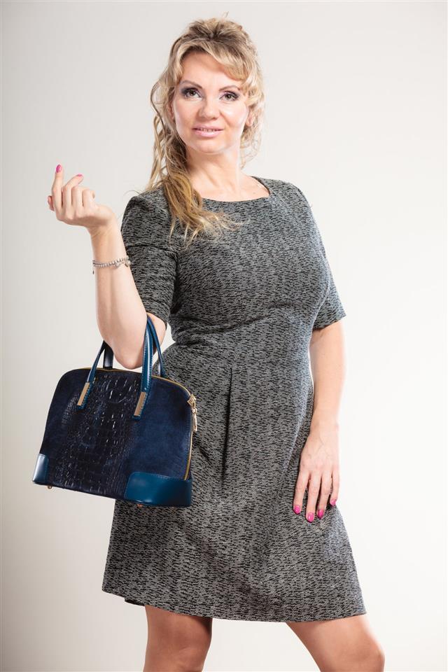 Mature Lady With Handbag