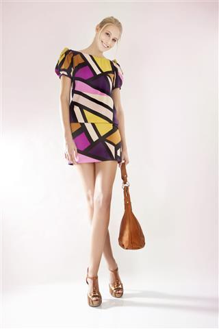 Young Woman Wearing Patterned Mini Dress