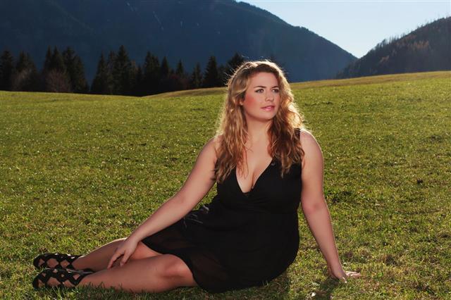 Woman Half Lying On Meadow