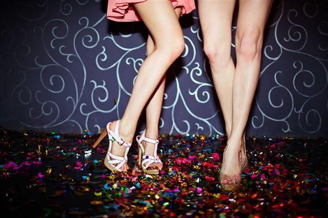 Legs Of Dancers With High Heels